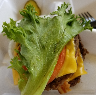 bacon cheeseburger on lettuce