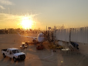 the sun and plane through the rainy window