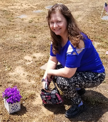 me with the flowers on my mom's grave